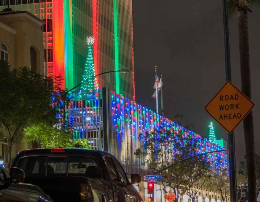 office building with multicolor lights and green tower tree lighting
