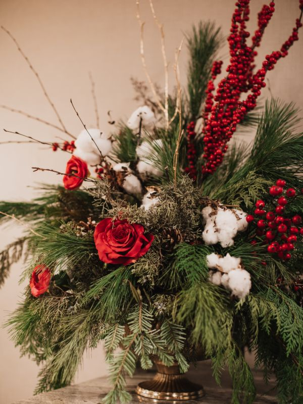 custom holiday centerpiece with red and white decoratoins