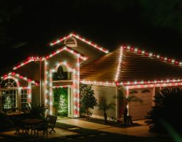 house decorated with red and white christmas lights