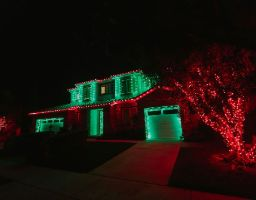 red and green residential house christmas lights