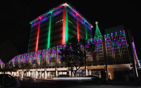 office building decorated with multicolor LED christmas lights