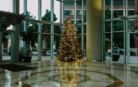 hotel lobby holiday tree decorated with warm white LED lights