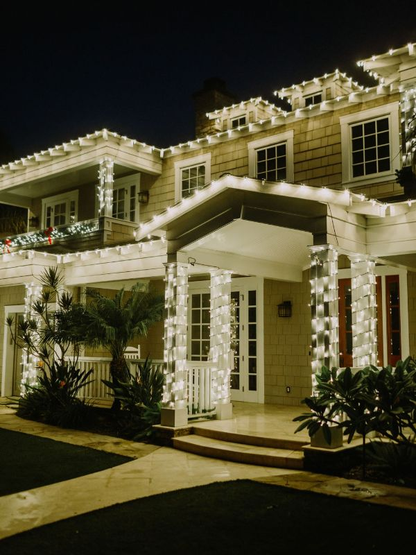 house and columns decorated with warm white led lights